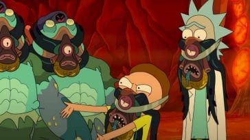 An angry Morty, dead facehugger strapped to his mouth, confronts the Glorzos.