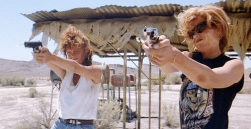 Thelma and Louise shooting guns in the desert