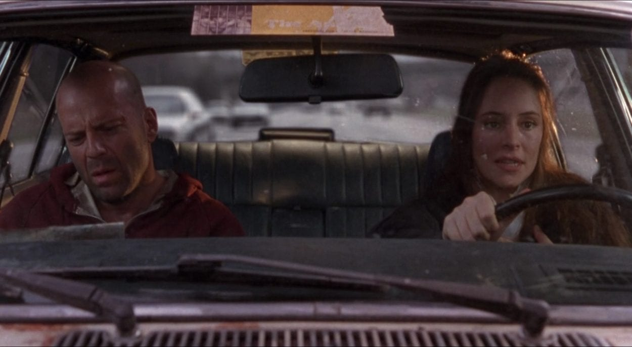 Cole (Bruce Willis) and Kathryn (Madeleine Stowe) are in a car