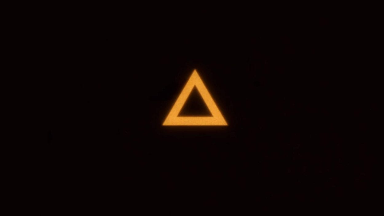 Yellowish-orange triangle floating in the middle of a black field