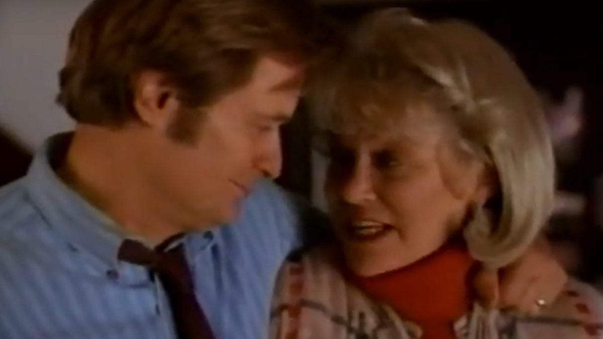 VR.5 - Mr. Bloom (David McCallum) and Mrs. Bloom (Louise Fletcher) look at each other happily