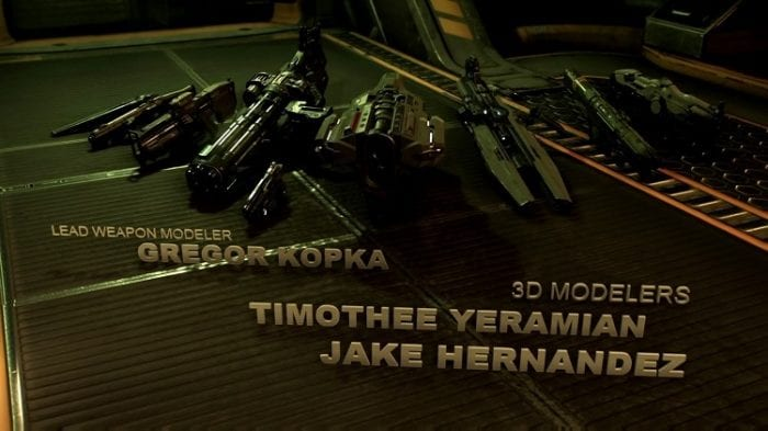 A shot of the credits of Doom 2016, which show off the game's arsenal and the weapon modeler and 3d modeler credits beneath them