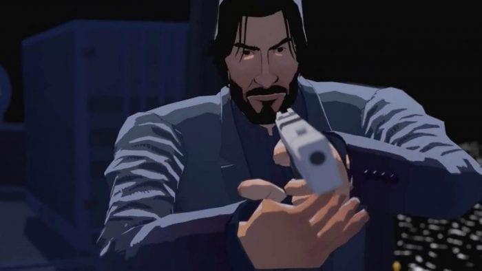 John de John Wick Hex pointe un pistolet, prêt à l'action