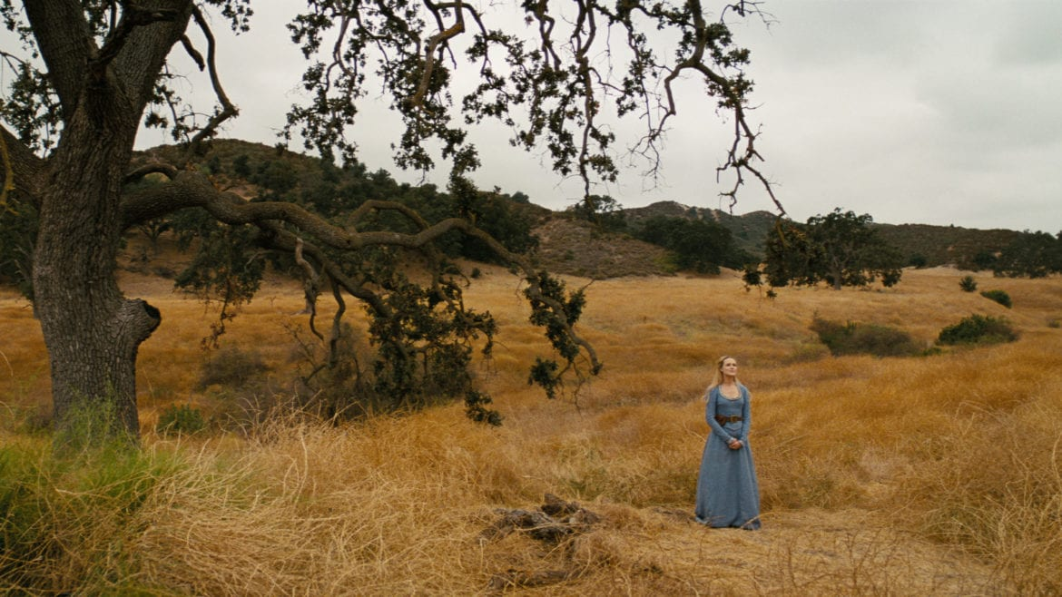 Dolores stands surrounded by the beauty of Westworld's nature
