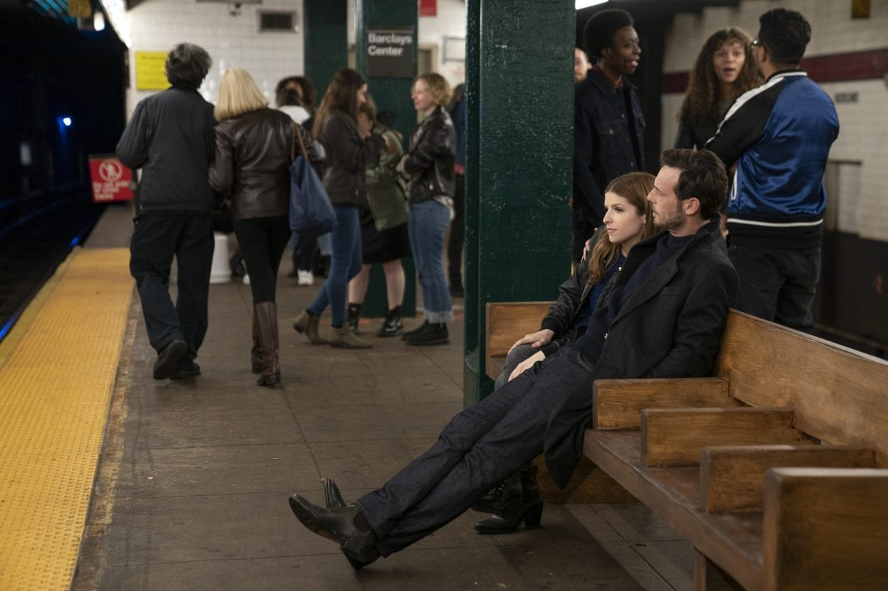 Darby and Bradley (Anna Kendrick and Scoot McNairy) sit on a subway station bench together.