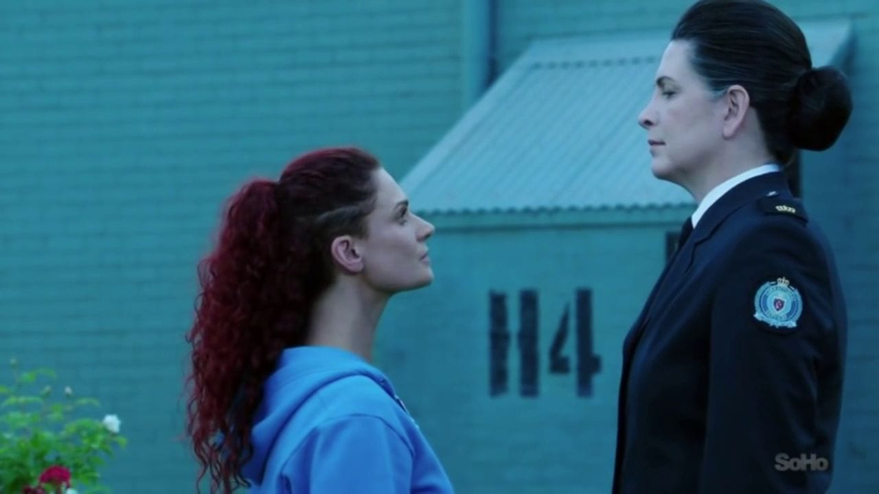 "Bea (Danielle Cormack) stands up against Governor Joan Ferguson (Pamela Rabe) in a scene from ""Wentworth"""