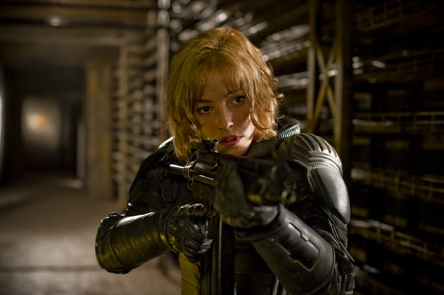 Judge Anderson holds up a machine gun