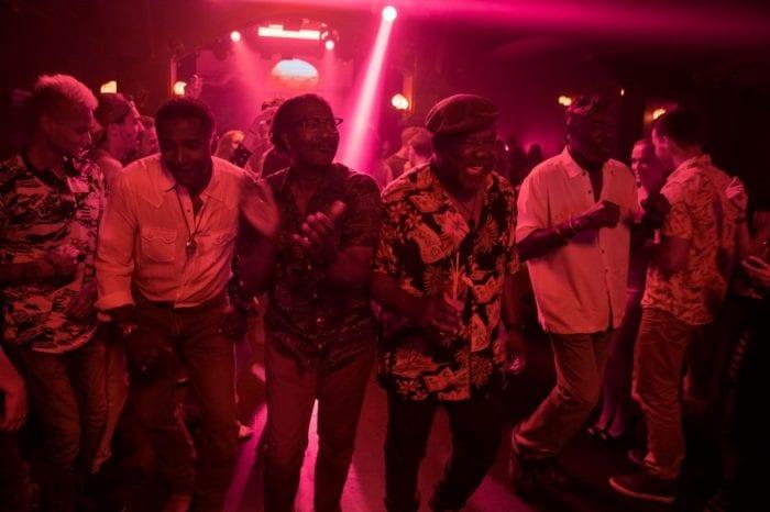 Five senior black men dance to old hits at a Vietnamese night club.