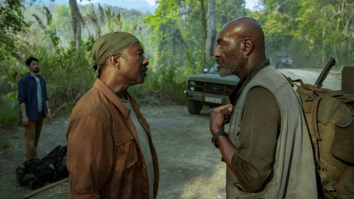 Otis confronts a combative Paul on a roadway path in Vietnam.