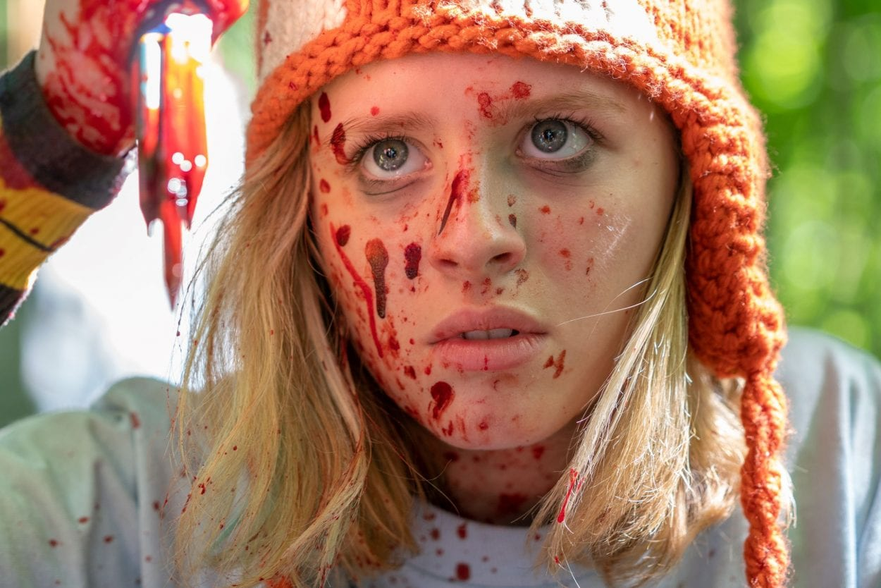 A blood-soaked Becky holds up a cluster of colored pencils used to stab someone.