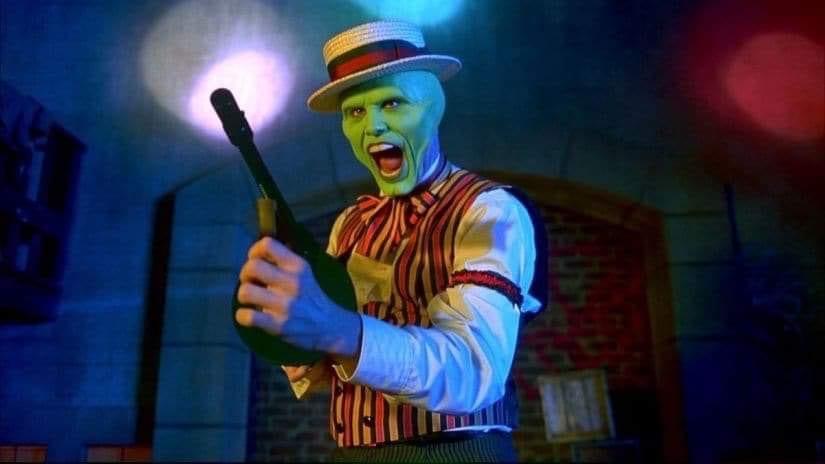 The Mask firing off a tommy gun