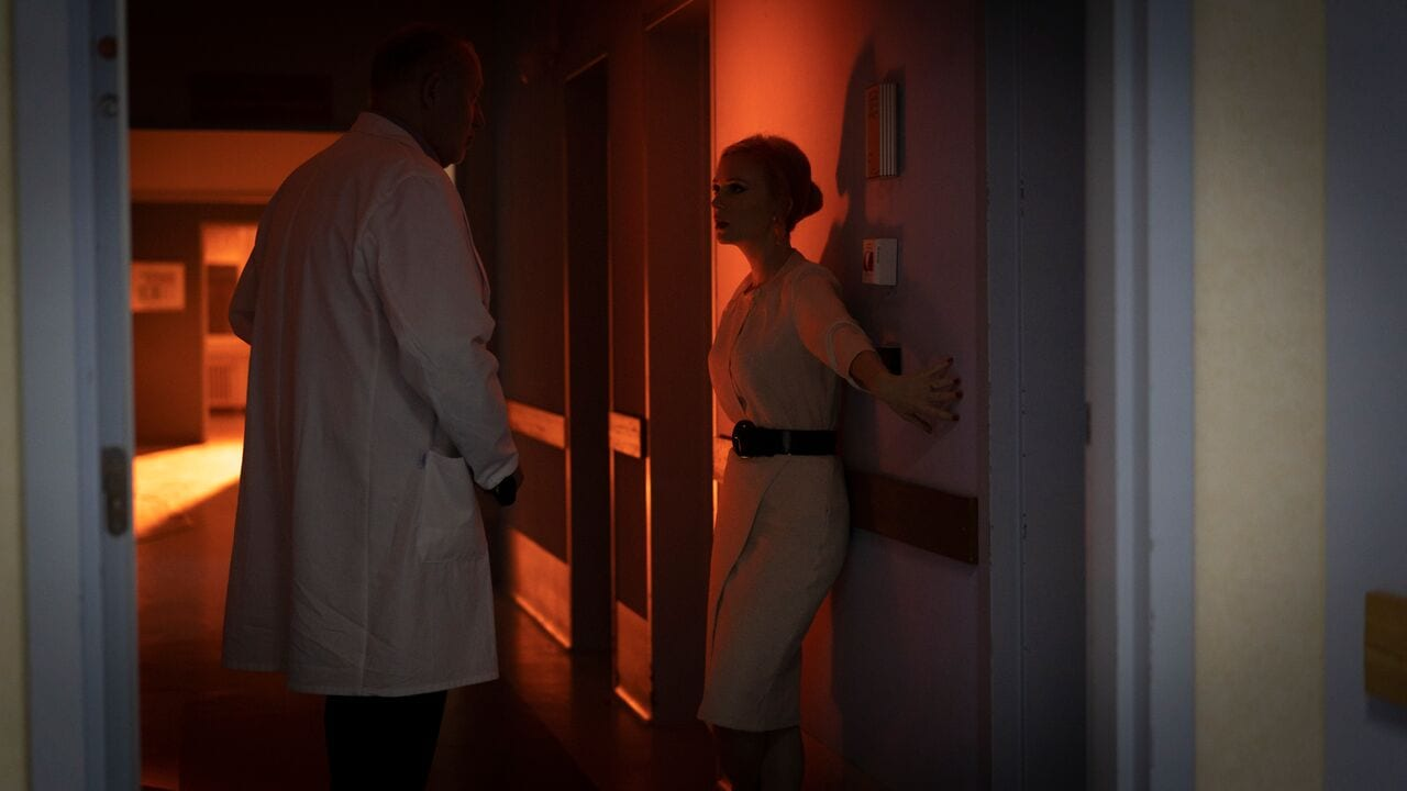 Doctor and nurse in hallway talking
