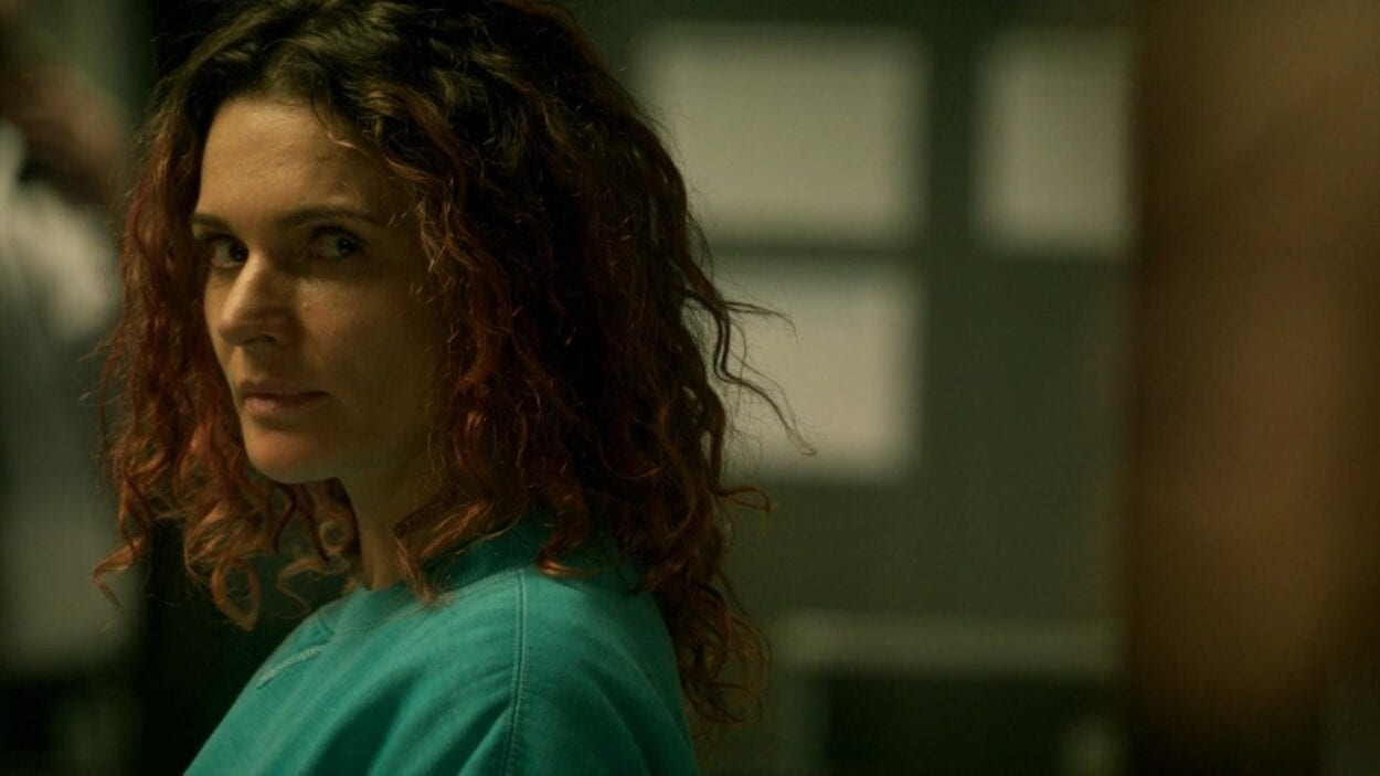 Bea (Danielle Cormack) looks over to Allie (Kate Jenkinson) in a scene from Wentworth.