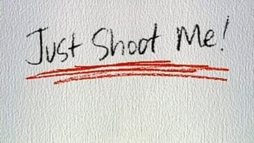 Just Shoot Me written in black and underlined in red