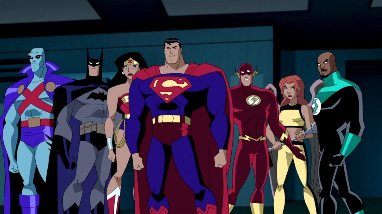 Martian Manhunter, Batman, Wonder Woman, Superman, Flash, Hawkgirl and Green Lantern stand together