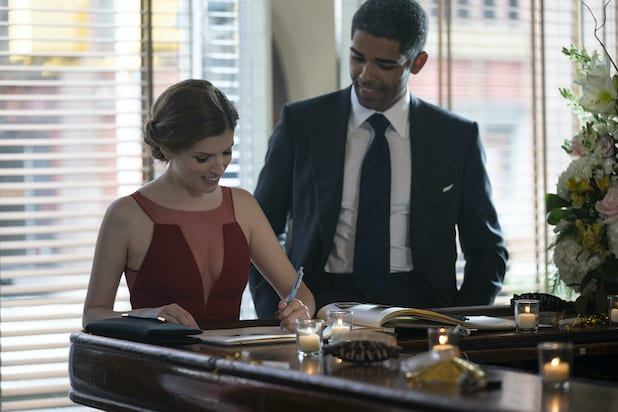 Darby and Grant (Anna Kendrick and Kingsley Ben-Adir) sign a wedding guest book.