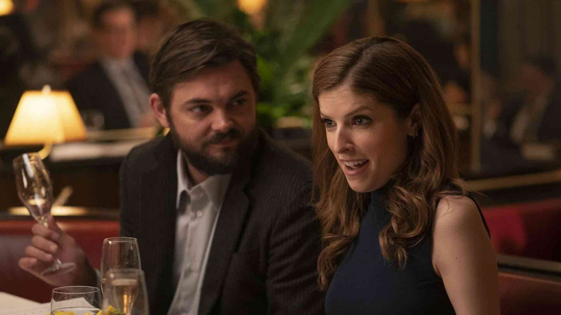 Magnus and Darby (Nick Thune and Anna Kendrick) sit in a restaurant together. Magnus looks at Darby, and Darby looks in bewilderment at an unseen dinner guest.
