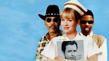 Charlie and Wesley stand behind Betty who's holding a photo of George McCord in Nurse Betty