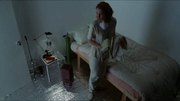 Carol White (Julianne Moore) walks around the inside of a secured and chemical-free room in her house before getting ready to leave