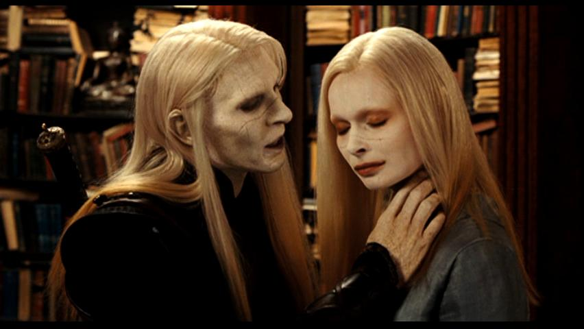 Prince Nuada threathens his sister Nuala in what looks like a library