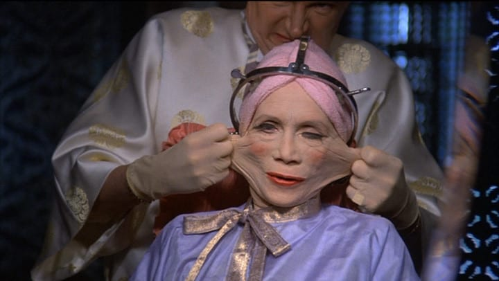 A surgeon stretches the plastic features of Ida Lowry (Katherine Helmond)