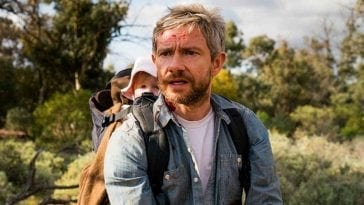 Andy carries his daughter through the Australian outback