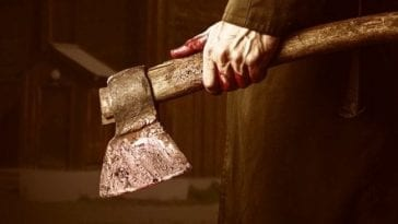 A bloody hand holds a hatchet