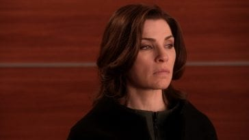 Alicia Florrick looks on