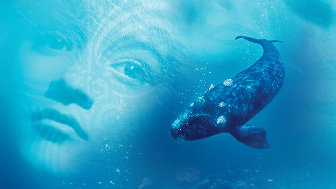 Paikieas face is side by side with a whale within in a watery background