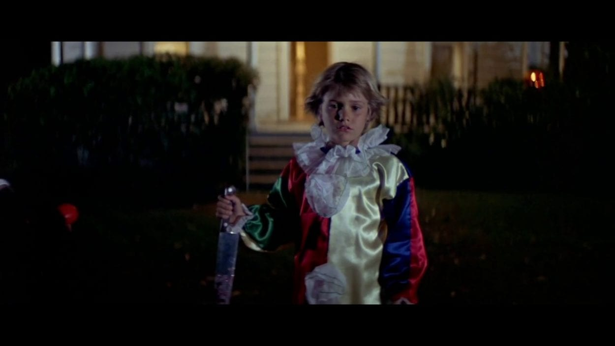 Young Michael Myers in clown costume.