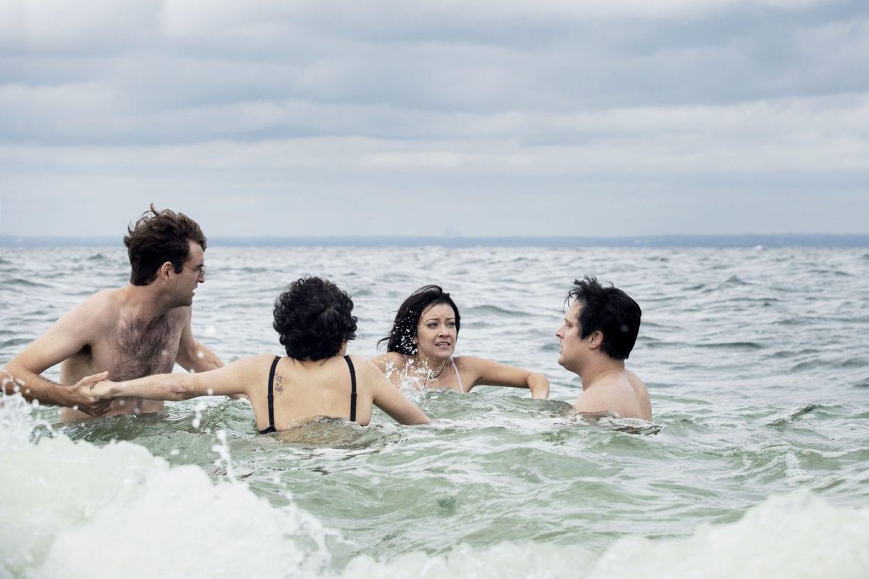 Drew, Dory, Portia, and Elliott swim in the ocean.