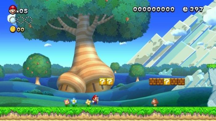 Mario runs through the Acorn Tree introductory level of New Super Mario Bros. U Deluxe.