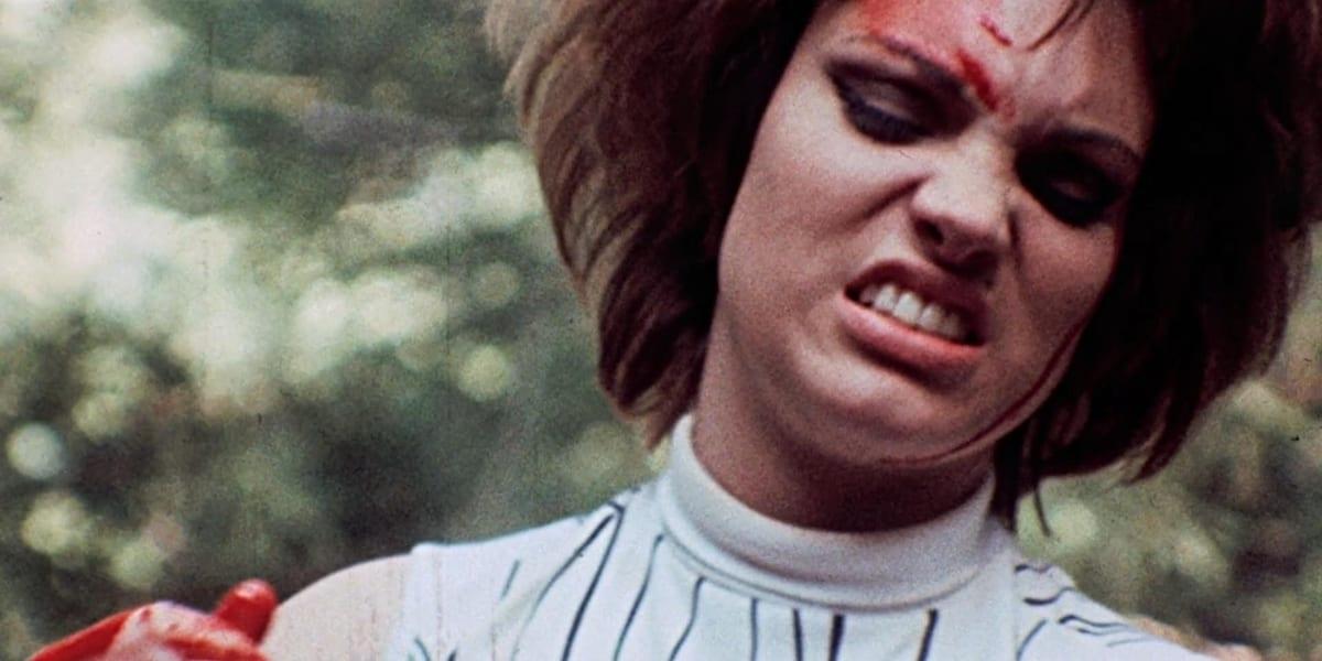 Sadie grimacing, covered in blood