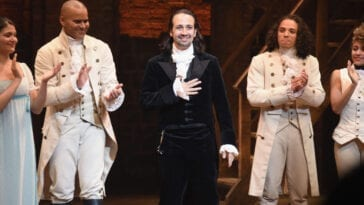 Lin-Manuel Miranda at curtain calls, flanked by Christopher Jackson and Anthony Ramos