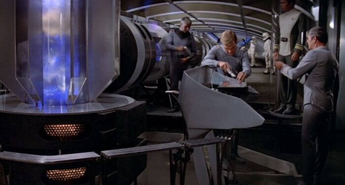 Decker and Scotty work in the Enterprise's engine room