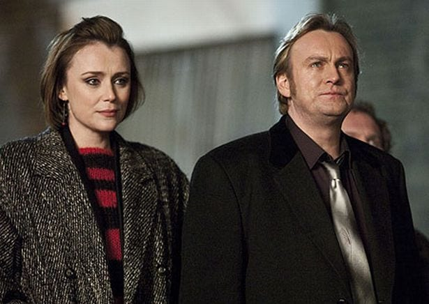 "Alex Drake (Keeley Hawes) and the Guv (Philip Glenister) look off into the distance at a pub in ""Ashes to Ashes"""