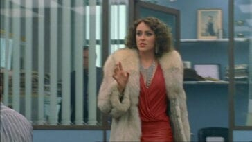 "Alex Drake (Keeley Hawes) walks through a police station, trying to figure out how she ended up in 1981 in ""Ashes to Ashes"""