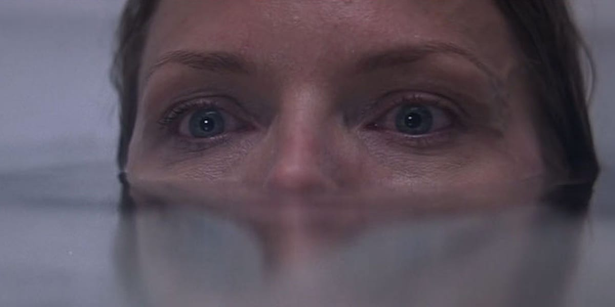 Claire in the bathtub in What Lies Beneath, eyes and nose barely above water, looking ahead in fear