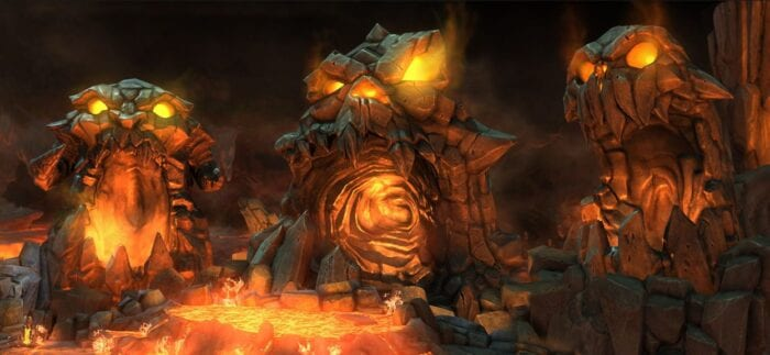 A hellish scene, three faces made from charred rocks lay side by side in front of a fiery pit
