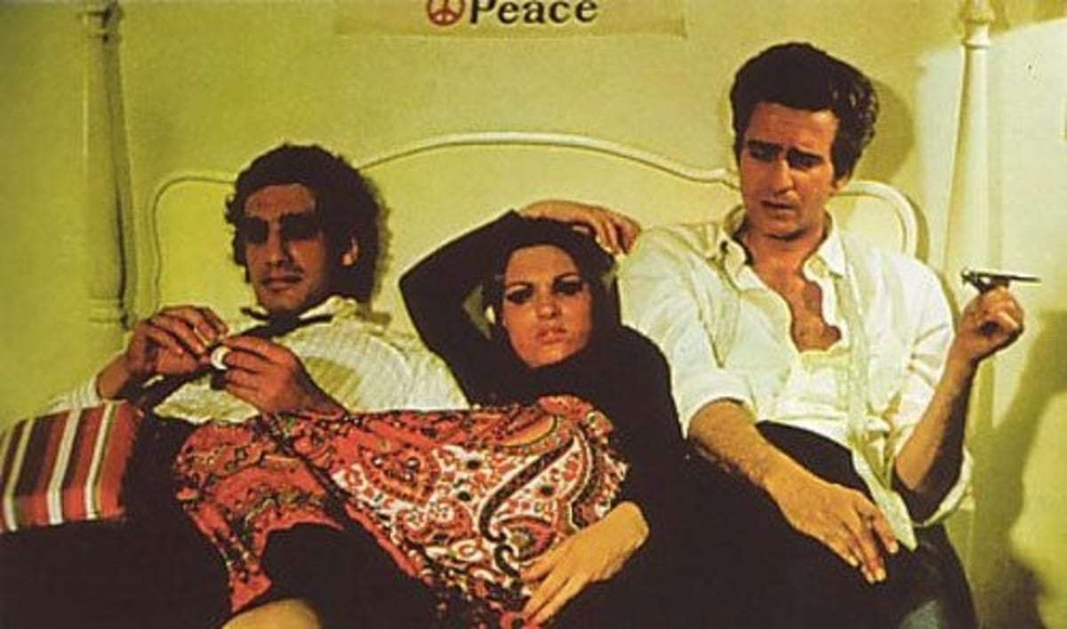 Krug, Weasel, and Sadie lay in bed together