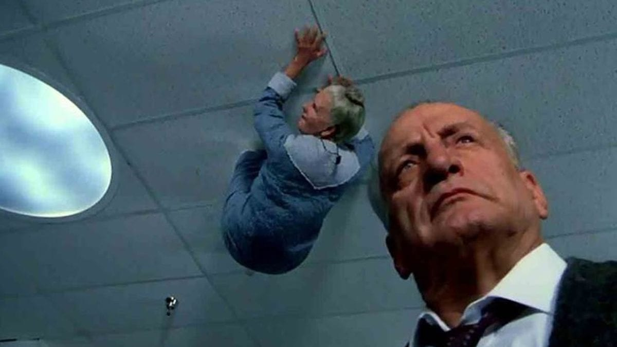Lt. Kinderman is being watched by an old woman on the ceiling