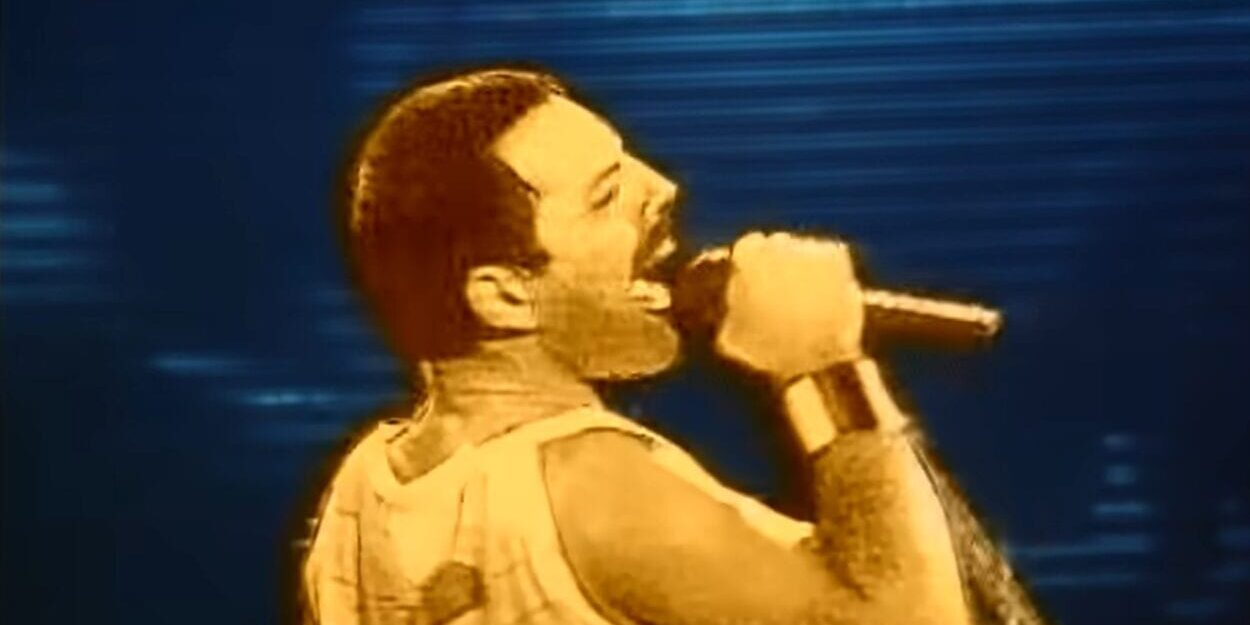 "An animated version of Freddie Mercury sings into a microphone in the music video for ""Innuendo"""
