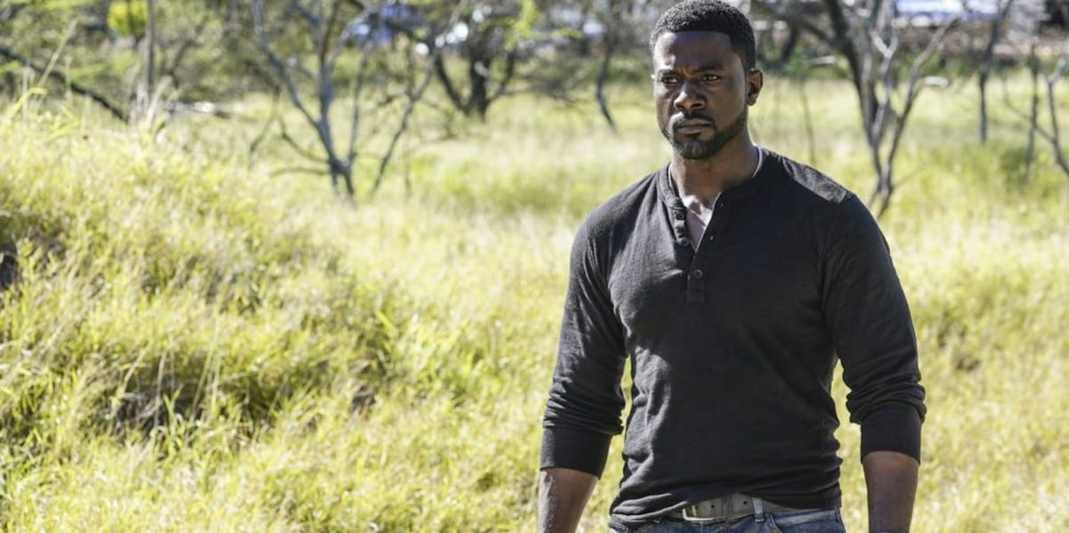 Lincoln Cole in the middle of a field in Hawaii Five-0, looking angry