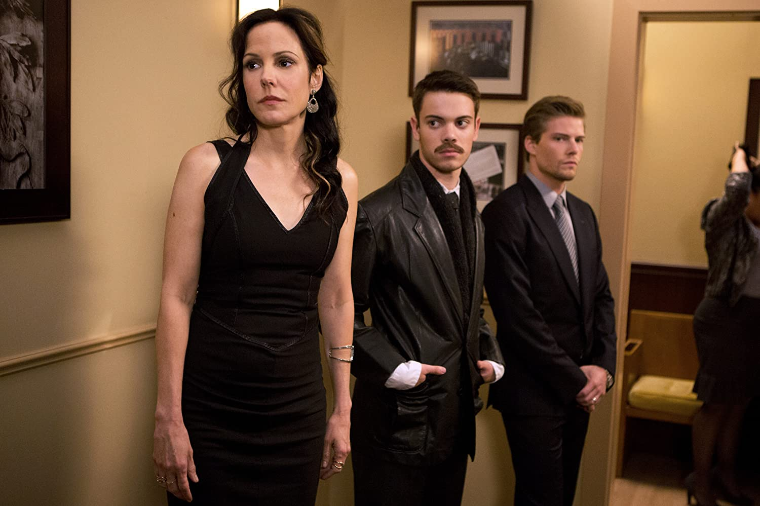Nancy, Shane, and Silas stand in a hallway without facing each other in the Weeds finale