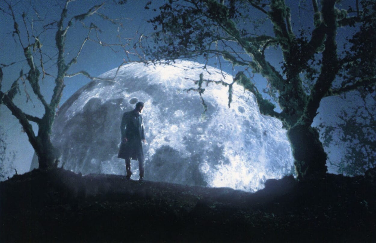 Gigolo Joe turns to see the moon rising between two trees