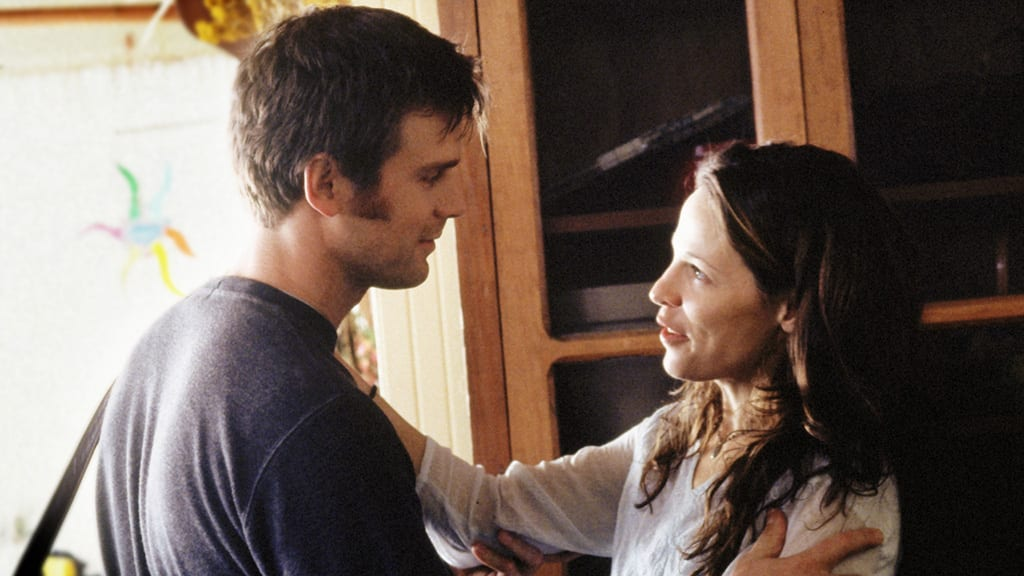 Nate and Lisa embrace as they speak in Six Feet Under