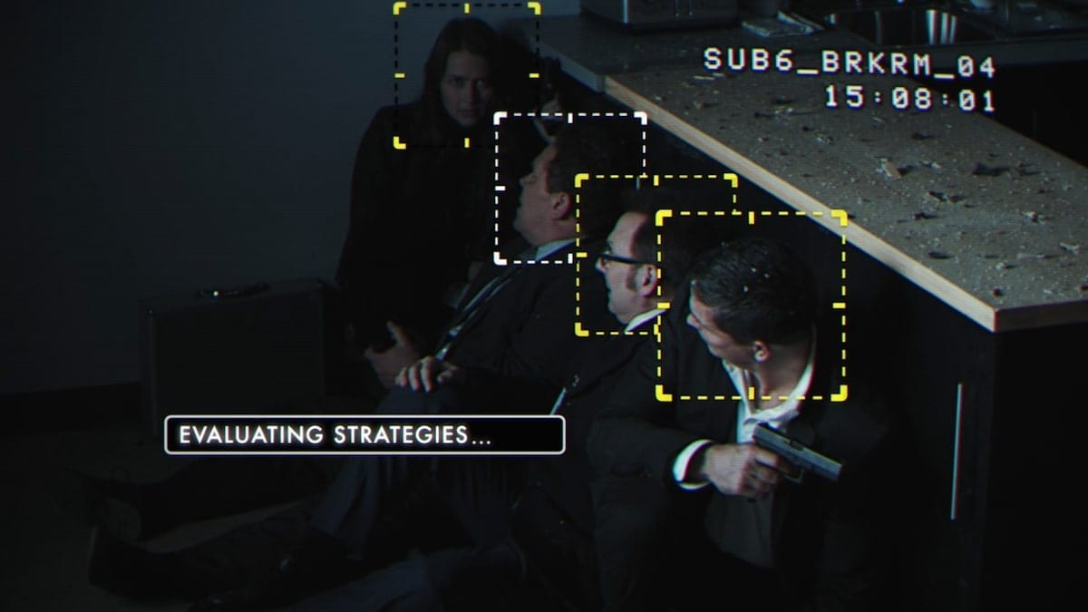 Root (Amy Acker), Lionel Fusco (Kevin Chapman), Harold Finch (Michael Emerson), and John Reese (Jim Caviezel) taking cover behind a counter, as seen with the Machine's UI