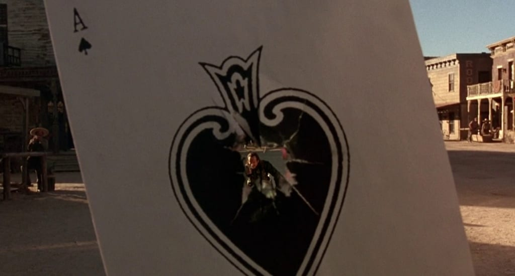 Ace can be seen through the hole in a playing card he shot through
