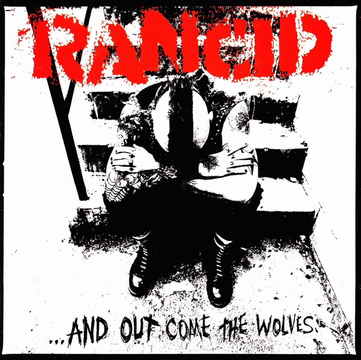 """a washed out black and white image of a punk rocker with a mohawk sitting on steps, head leaning into his chest. The word """"Rancid"""" is in red above him."""