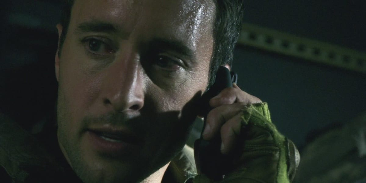 Steve in the Pilot of Hawaii Five-0, looking to his right, speaking on the phone, looking intense